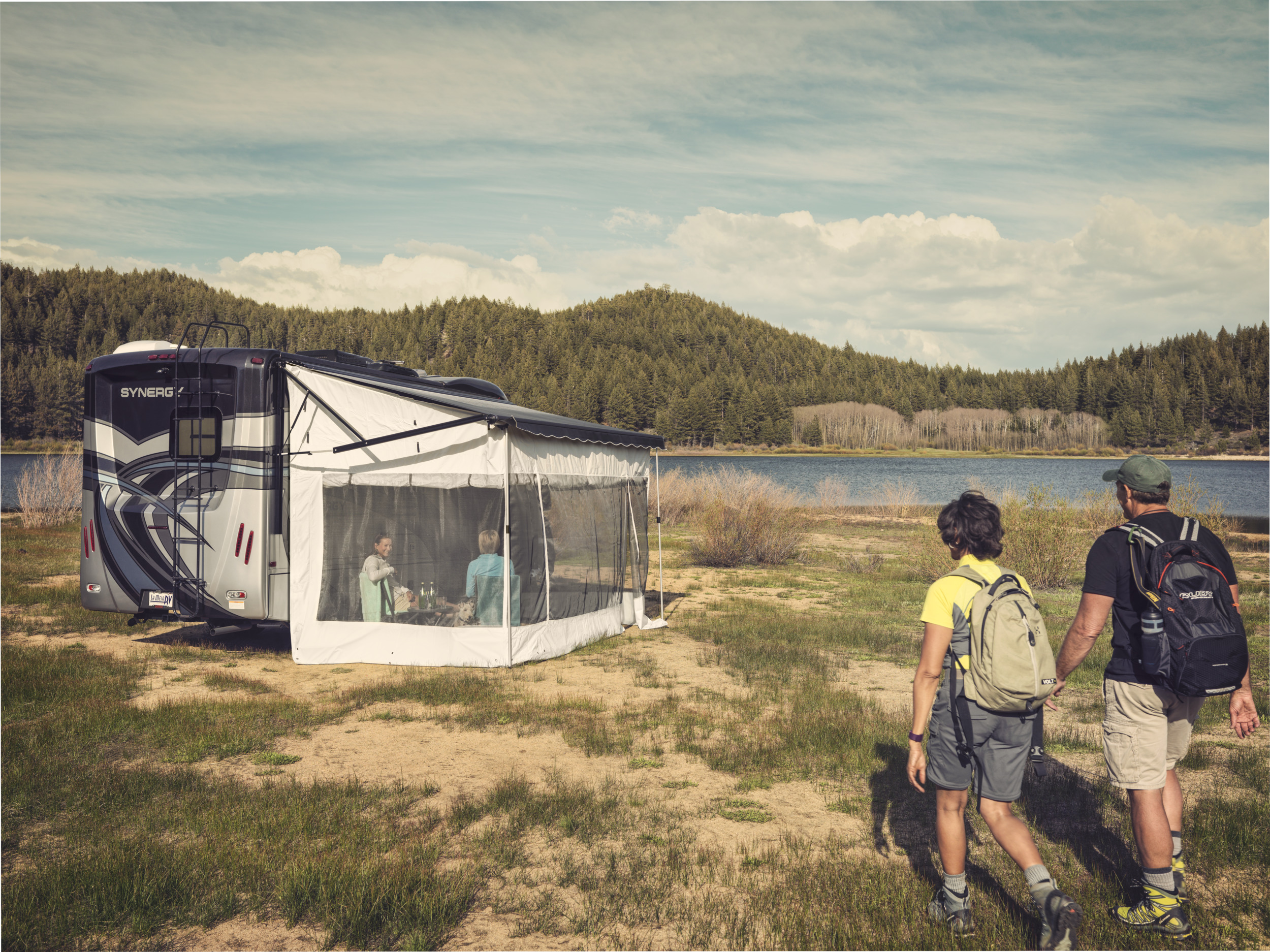 Dometic rv motorhome hiking awning tent, shelter, rv, motorhome, tent, awning, grass, lake, hike, rugsack, father, son, family, nature, picnic
