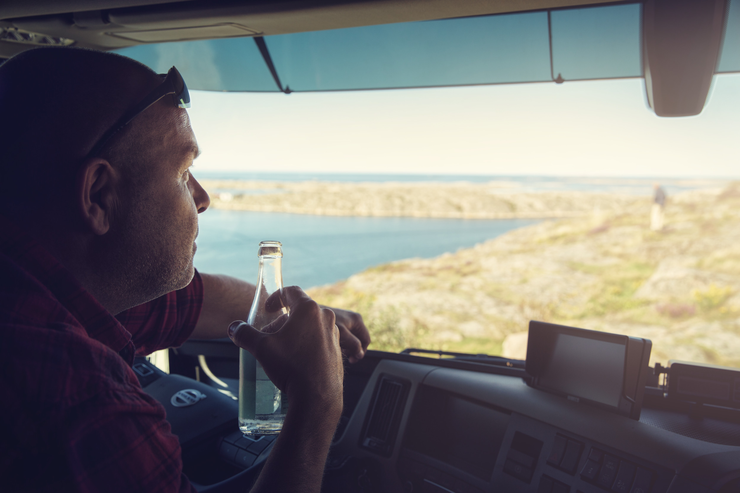 bottle, water, drink, dashboard, truck, travel, transport, transportation, seaside, rocks, cliffs, lighthouse, glasses, gps, tom tom